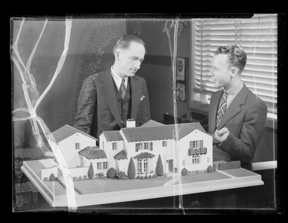 Boy with model house, Southern California, 1936