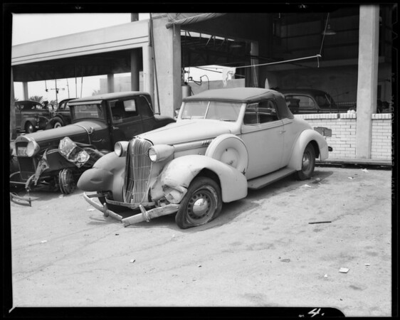 Bernstein Ford roadster and other party Oldsmobile convertible coupe, Southern California, 1940
