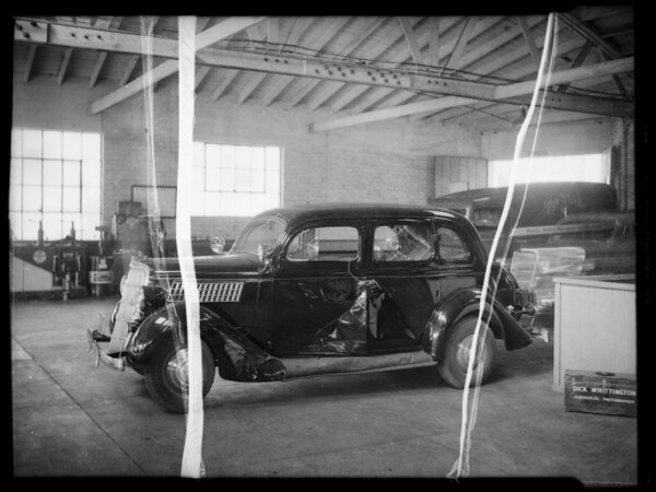 Wrecked Ford sedan, L.W. Zimmerman owner and assured, Southern California, 1935