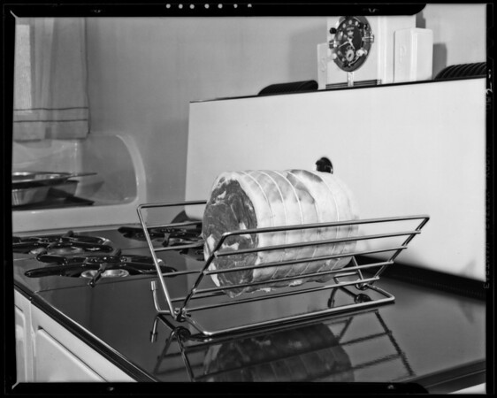 Oven rack with Miss Kitchner, Los Angeles, CA, 1940
