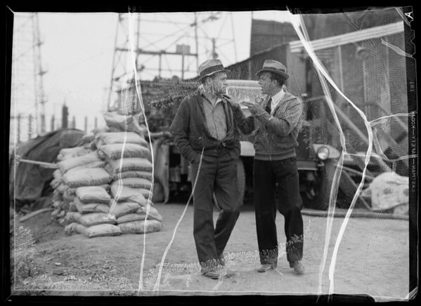 """Perferating Pete"" and Field Foreman in offices, etc., Southern California, 1936"