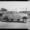 Damaged 1940 Dodge and intersection of Hildreth Avenue and Tenaya Avenue, Southern California, 1940