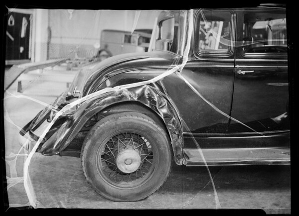 Wrecked Oldsmobile coupe, Mrs. Bert owner and assured, Southern California, 1936