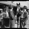 Sport suits at stable, Southern California, 1935
