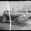 Wrecked Plymouth coach owned by Jack Askins, Newells Market Co. is the assured, Southern California, 1935
