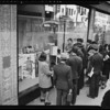 Crowds looking at Maytag window, Southern California, 1940
