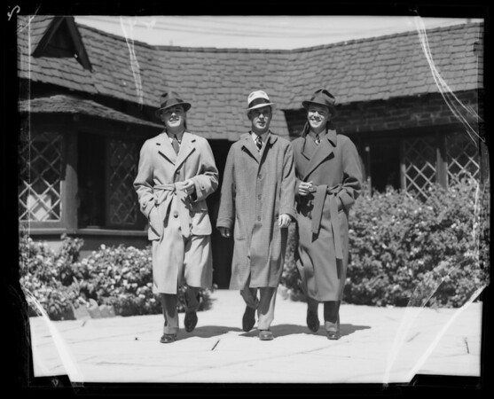 Action in suits and overcoats, Southern California, 1935