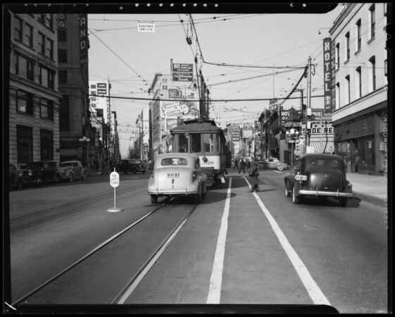 Safety zone and skid marks at West 9th Street and South Main Street, Los Angeles, CA, 1940