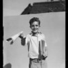 Edward as newsboy, Southern California, 1935