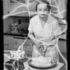 Cake and girl frosting cake, Southern California, 1936
