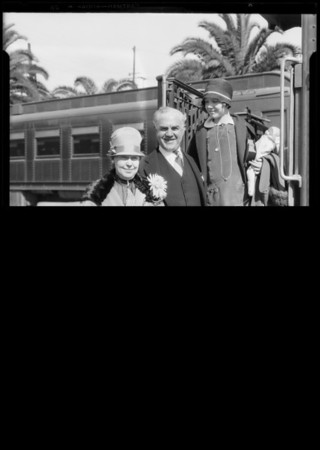 Burton Churchill and wife at Santa Fe Depot, Southern California, 1927