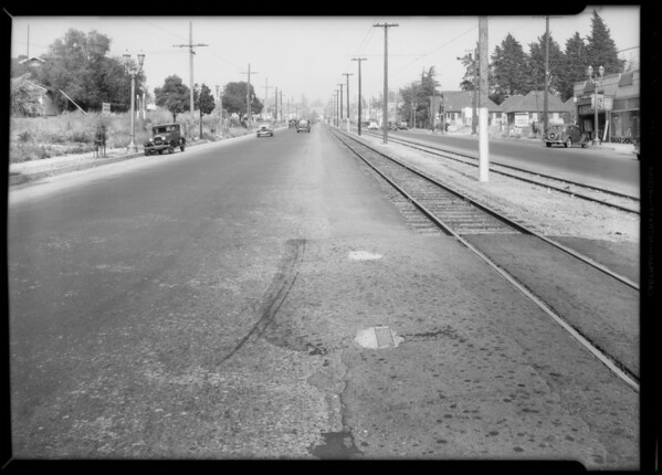 Skid marks on Colorado Street in Eagle Rock in front of Hart Motor Company, Los Angeles, CA, 1935