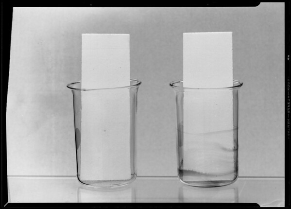 Trays and beakers to show stains, Southern California, 1940