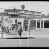 Service station at South Western Avenue and West Washington Boulevard and rear end of car, Southern California, 1936