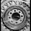 Wheel and tire from Busby Berkeley car in police crime lab, Southern California, 1935