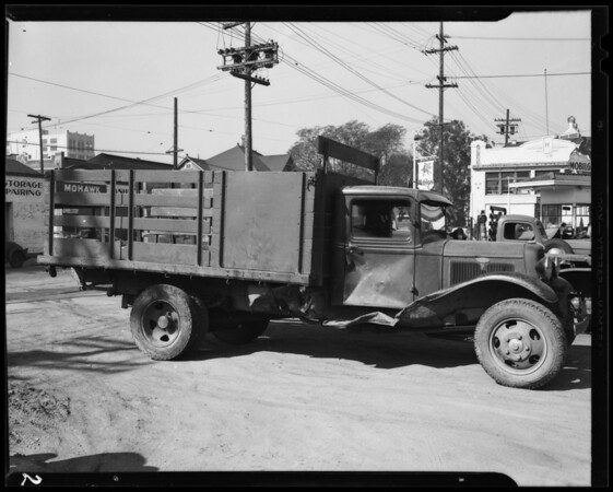 Damage to Ford truck and intersection of West Pico Boulevard and South Grand Avenue, Los Angeles, CA, 1940