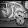 Wrecked 1937 Buick sedan at B&M Auto Works, 1340 South Olive Street, Los Angeles, CA, 1940