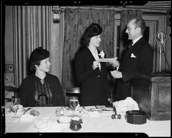 Check presentation at a club luncheon, Los Angeles, CA, 1940