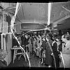 Shirley Ann [Ann Richards] signing photos, Los Angeles, CA, 1936