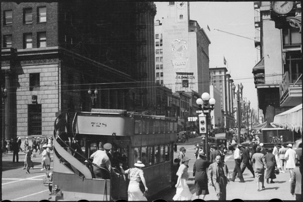 Unloading buses on city streets, Pacific Railroad Advertising Co., South Olive Street & West 7th Street, Los Angeles, CA, 1937
