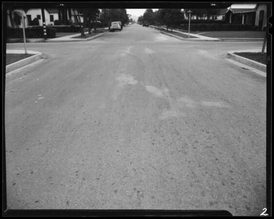 Skid marks at intersection of Hubbard Street and Hoefner Avenue, East Los Angeles, CA, 1940