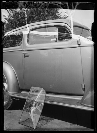 Chevrolet sedan, showing damage to door and glass, Southern California, 1936