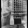 Milk bottle, dinner pail, building background, Southern California, 1936