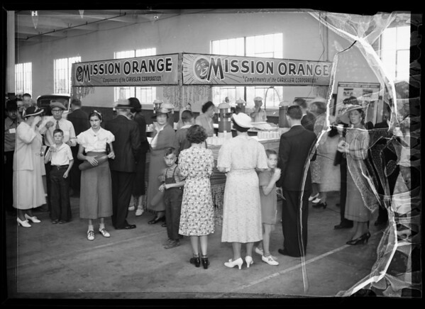 Crowd at orange juice booth at Chrysler plant, Southern California, 1936