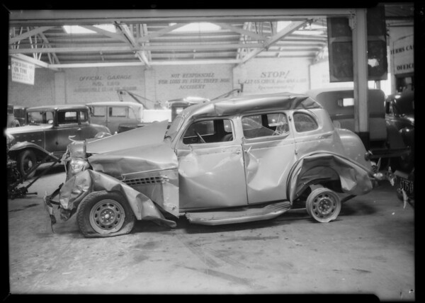 Wrecked DeSoto sedan owner and assured is Ideal Food Products Company, wrecked Chevrolet sedan and intersection of West Pico Boulevard and La Cienega, Southern California, 1935