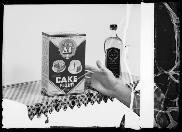 Hand reaching for package of cake flour, Southern California, 1936
