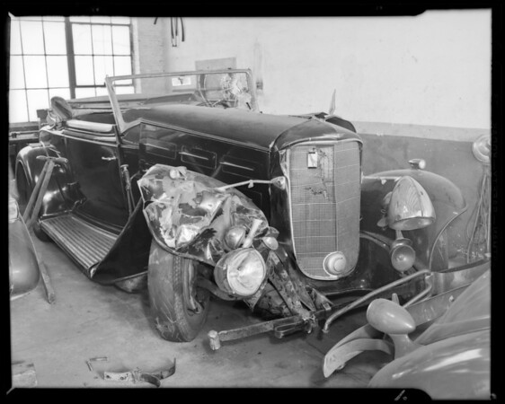 Packard sedan, Dr. Kinyon owner and Cadillac coupe, Gerhart owner & assured, Los Angeles, CA, 1940
