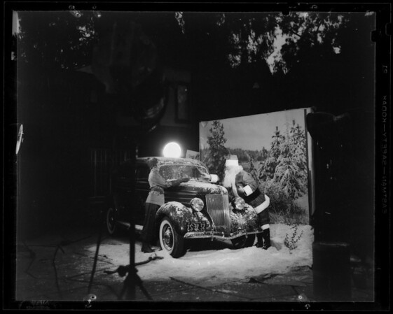 Shooting snow scene at studio, Ford and Santa Claus, Southern California, 1935