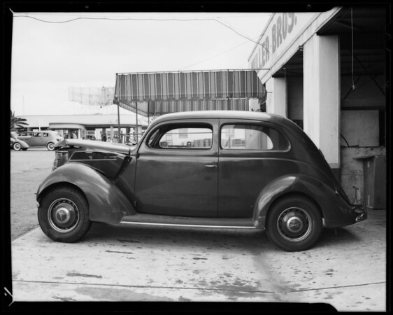 1937 Ford Tudor at Muller Bros. and 1931 Ford roadster at Coast Auto Works, Southern California, 1940