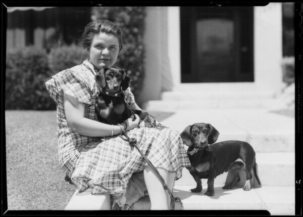 Mrs. Giles and dachshunds, Southern California, 1935