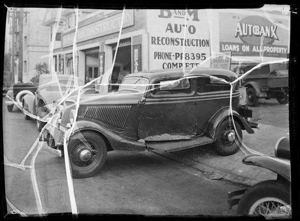 Wrecked two door 1934 Ford sedan, Southern California, 1935