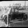 Chevrolet coupe and Ford coupe, license #8D50, intersection of Crenshaw Boulevard and Jefferson Boulevard, Los Angeles, CA, 1935
