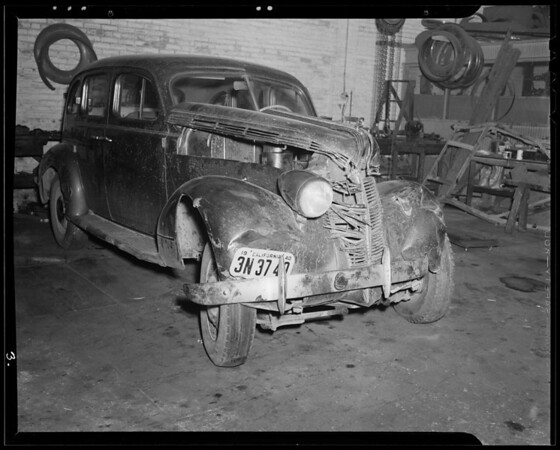 Wrecked 1937 Pontiac sedan and 1932 Ford coupe, 11562 Santa Monica Boulevard, Los Angeles, CA, 1940