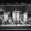 Tire window display at night, Southern California, 1927