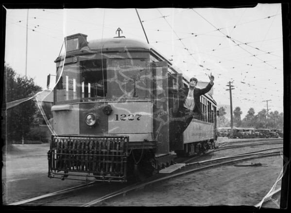 Street car and crowds for dollar day composite, Southern California, 1935