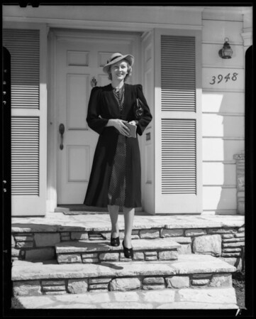 Girl leaving house to go shopping, Los Angeles, CA, 1940