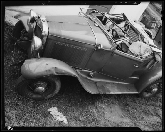 "West Olympic Boulevard and South Lucerne Boulevard, wrecked Ford ""A"" roadster, Los Angeles, CA, 1940"