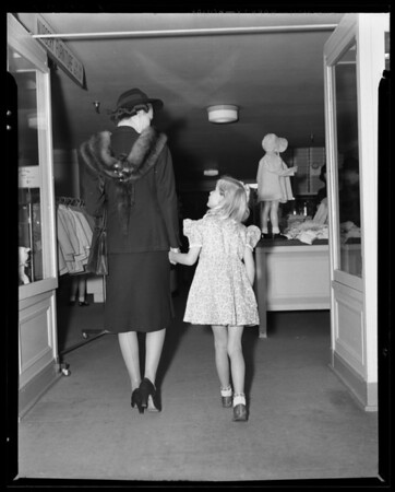 Child and mother in infants department at May Co, Southern California, 1940