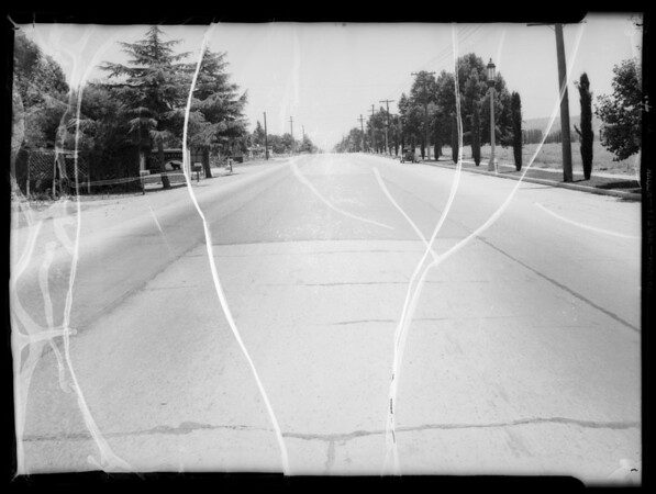 Street shots on Ventura Boulevard in front of 15501, Hamilton vs. Hammond Lumber Company, Los Angeles, CA, 1935