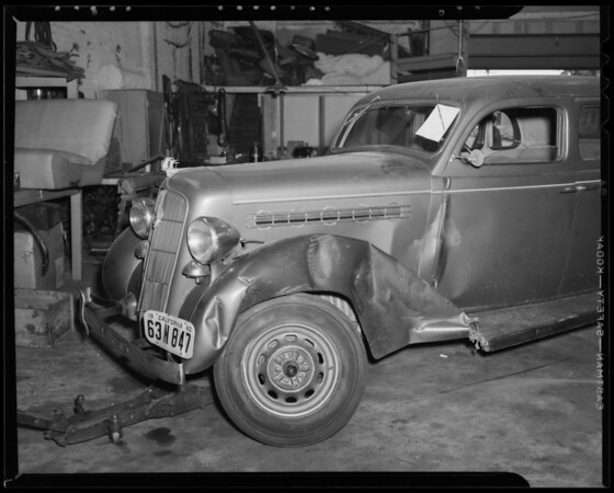 Wrecked Plymouth sedan, Bell Auto Works, 1633 South Hope Street, Los Angeles, CA, 1940