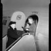 Mrs. V.G. Ryker boarding TWA plane, Burbank, CA, 1940