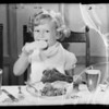 Kiddie eating turkey leg, Southern California, 1935