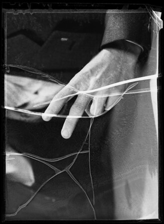 Hand with two fingers raised for composite, Southern California, 1935