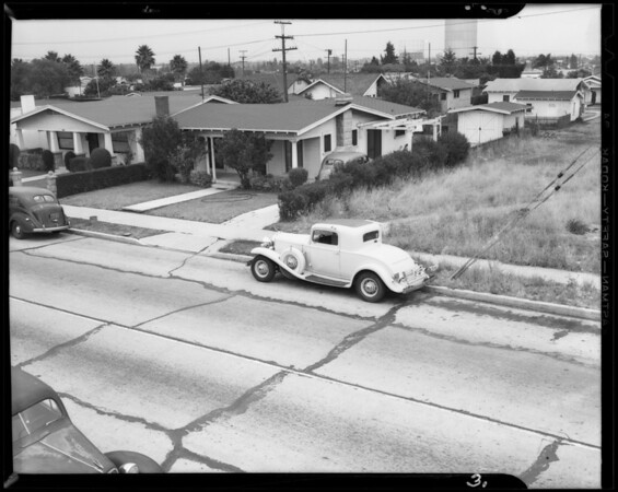 Parked car and intersection of 8th Avenue and Hyde Park Boulevard, Los Angeles, CA, 1940