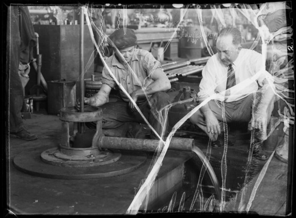 Pump being installed in test well, Southern California, 1935