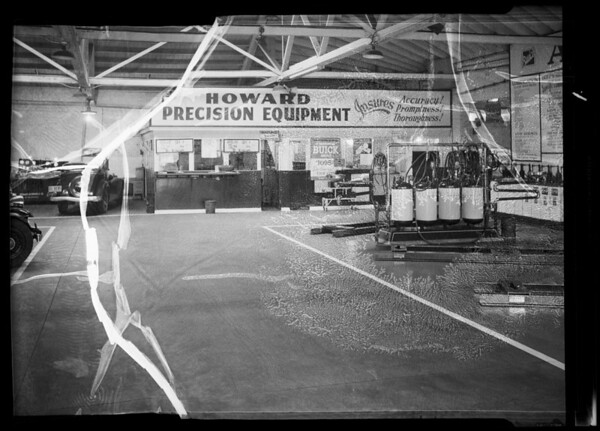 Floor near grease rack and cashier's cage in Howard Auto Service department, Southern California, 1936